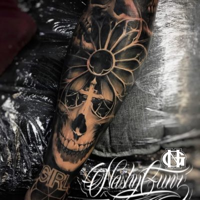 Skull tattoo in black and grey realism by Nashy