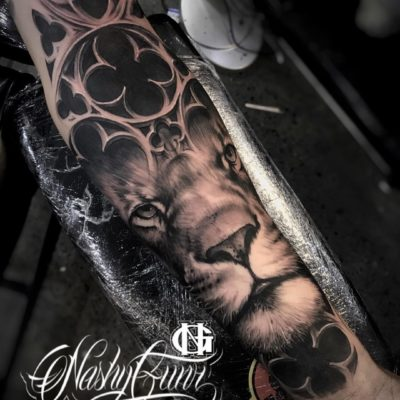 Lion tattoo in black and grey realism by Nashy