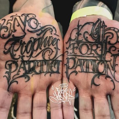 Script tattoo on palms by Yas Vo